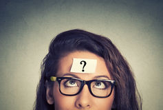 re_thinking-woman-question-mark-gray-wall-background-58534129